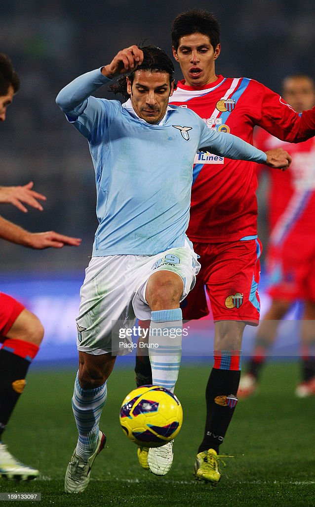 <a gi-track='captionPersonalityLinkClicked' href=/galleries/search?phrase=Sergio+Floccari&family=editorial&specificpeople=675401 ng-click='$event.stopPropagation()'>Sergio Floccari</a> of S.S. Lazio in action during the TIM Cup match between S.S. Lazio and Calcio Catania at Stadio Olimpico on January 8, 2013 in Rome, Italy.