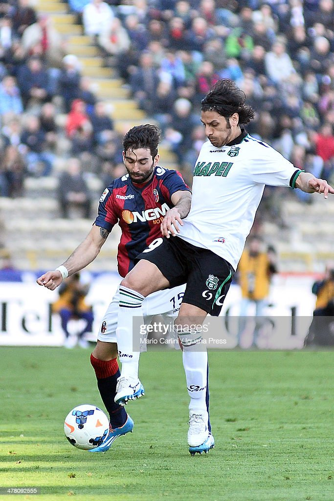 <a gi-track='captionPersonalityLinkClicked' href=/galleries/search?phrase=Sergio+Floccari&family=editorial&specificpeople=675401 ng-click='$event.stopPropagation()'>Sergio Floccari</a> #9 of US Sassuolo Calcio ( R ) competes the ball with Josè Angel Crespo # 75 of Bologna FC ( L ) during the Serie A match between Bologna FC and US Sassuolo Calcio at Stadio Renato Dall'Ara on March 9, 2014 in Bologna, Italy.