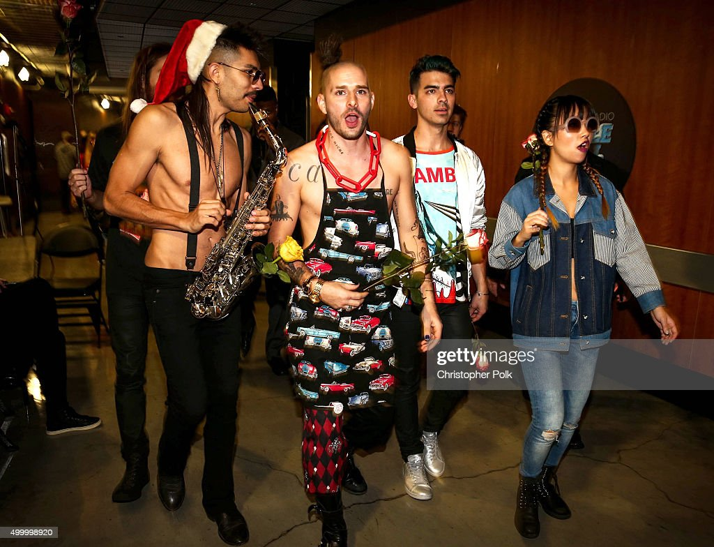 Sergio Flores aka 'Sexy Sax Man' and recording artists Cole Whittle, Joe Jonas and JinJoo Lee of music group DNCE attend 102.7 KIIS FM's Jingle Ball 2015 Presented by Capital One at STAPLES CENTER on December 4, 2015 in Los Angeles, California.