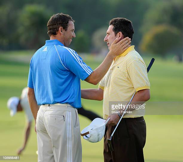 Sergio Garcia and Jose Maria Olazabal of Spain on the 18th hole during the second round of the Castello Masters Costa Azahar at the Club de Campo del...