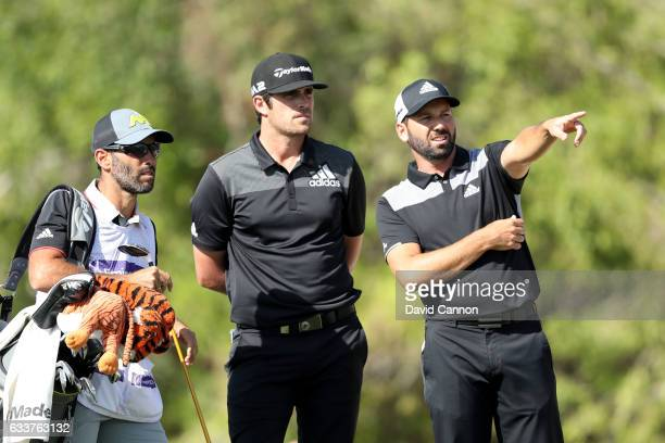 Sergio Garcia and Nacho Elvira of Spain look down the 3rd hole during the third round of the Omega Dubai Desert Classic at Emirates Golf Club on...
