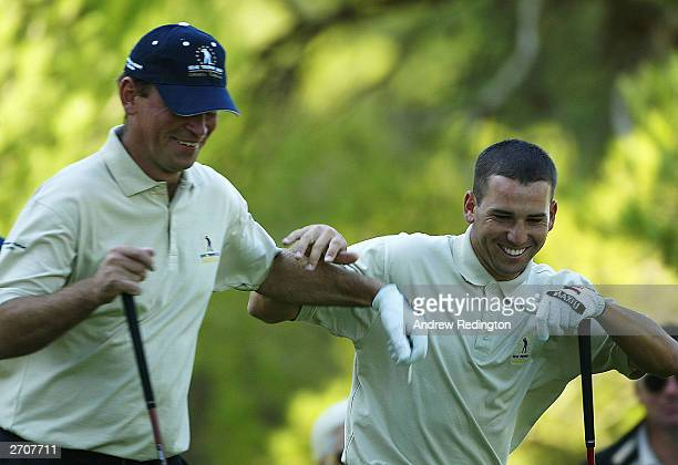 Sergio Garcia and Thomas Bjorn of the Continental Europe team share a light moment as they go to tee off on the 13th hole during the second day's...