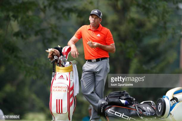 Sergio Garcia eats a sandwich on the 13th hole during the World Golf ChampionshipsBridgestone Invitational on August 3 at the Firestone Country Club...