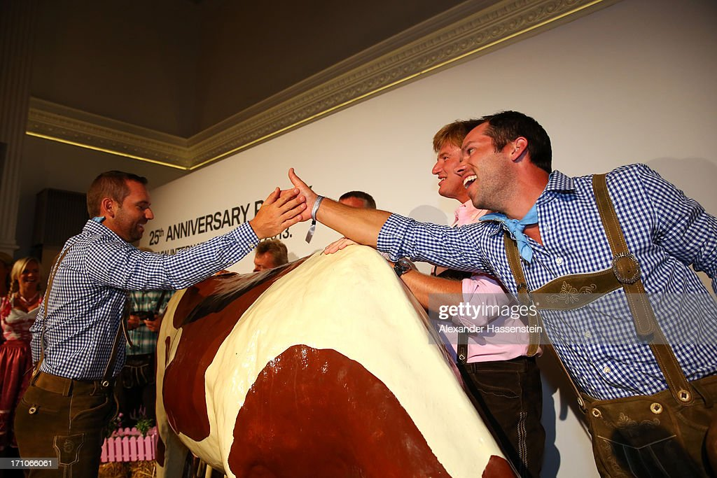 Sergio Garcia, Ernie Els and Paul Casey shake hands after competing in a cow milking fun competition during the BMW International Open 25th Anniversary Party at Rilano No.6 Lenbach Palais on June 21, 2013 in Munich, Germany.