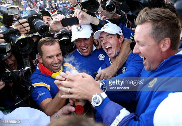 Sergio Garcia Lee Westwood Rory McIlroy and Ian Poulter of Europe celebrate winning the Ryder Cup after the Singles Matches of the 2014 Ryder Cup on...