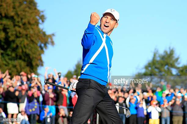 Sergio Garcia of Europe celebrates after he chipped in from a bunker on the 4th hole during the Morning Fourballs of the 2014 Ryder Cup on the PGA...