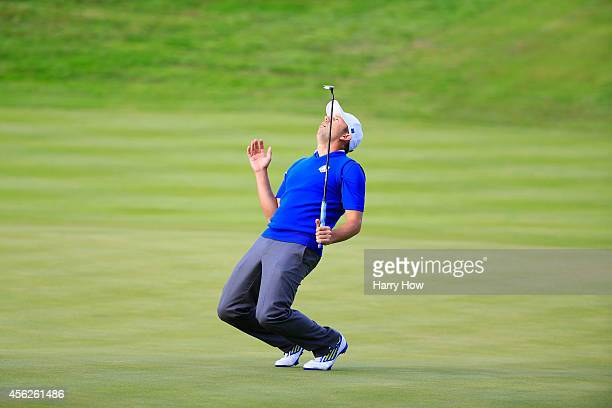 Sergio Garcia of Europe reacts to a putt on the 17th green during the Singles Matches of the 2014 Ryder Cup on the PGA Centenary course at the...