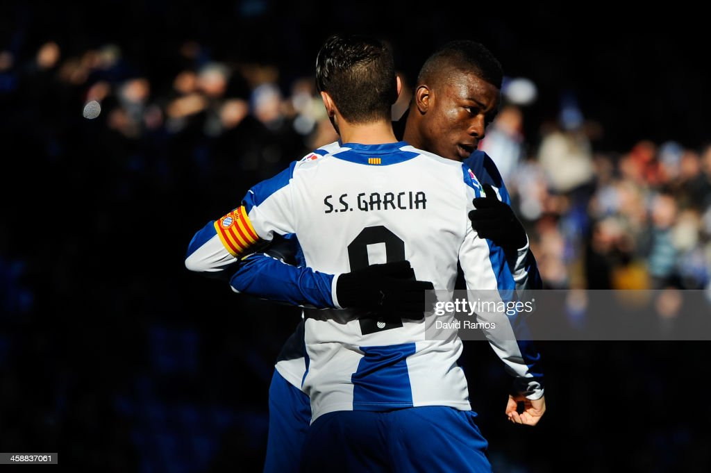 Sergio Garcia (L) of RCD Espanyol celebrates with his teammate Jhon Cordoba after scoring the opening goal from the penalty spot during the La Liga match between RCD Espanyol and Real Valldolid CF at Cornella-El Prat Stadium on December 22, 2013 in Barcelona, Spain.