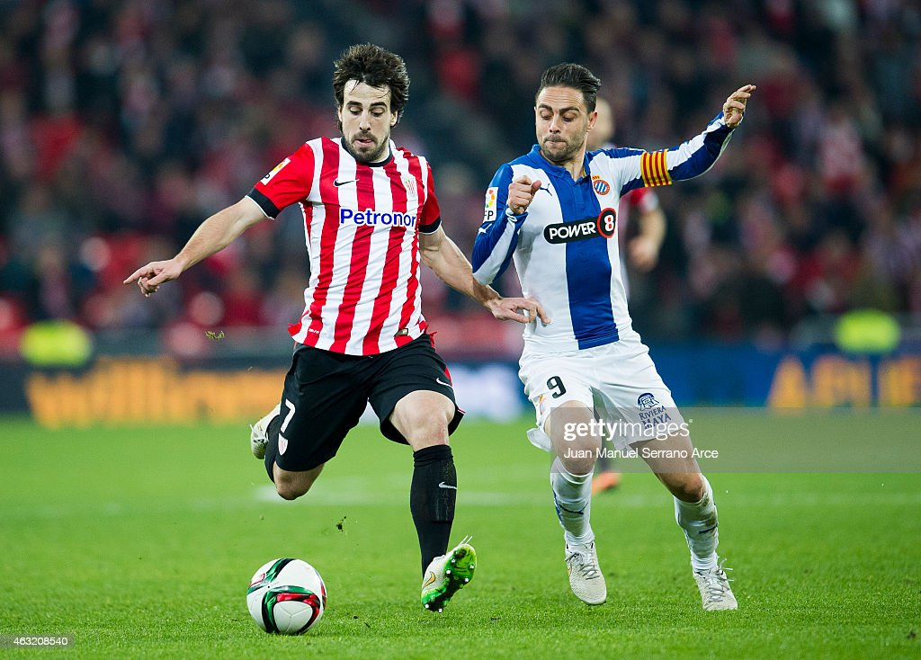<a gi-track='captionPersonalityLinkClicked' href=/galleries/search?phrase=Sergio+Garcia+-+Soccer+Player&family=editorial&specificpeople=5378767 ng-click='$event.stopPropagation()'>Sergio Garcia</a> of RCD Espanyol duels for the ball withÊ<a gi-track='captionPersonalityLinkClicked' href=/galleries/search?phrase=Benat+Etxebarria&family=editorial&specificpeople=8282511 ng-click='$event.stopPropagation()'>Benat Etxebarria</a> of Athletic Club during the Copa del Rey Semi-Final first leg match between Athletic Club and RCD Espanyol at San Mames Stadium on February 11, 2015 in Bilbao, Spain.