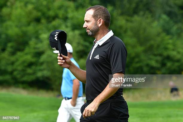 Sergio Garcia of Spain acknowledges the crowd after his hole in one on the 11th hole during the second round of the BMW International Open at Gut...