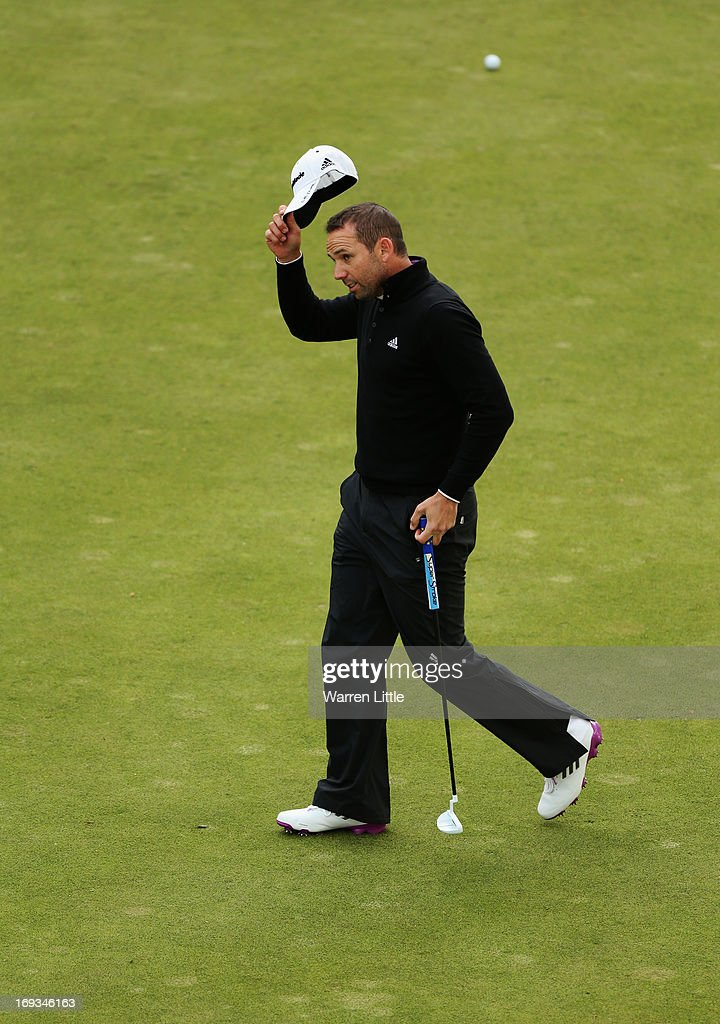 Sergio Garcia of Spain acknowledges the crowd on the 18th green during the first round of the BMW PGA Championship on the West Course at Wentworth on May 23, 2013 in Virginia Water, England.