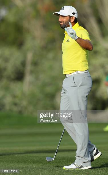Sergio Garcia of Spain acknowledges the crowd on the 18th hole during the final round of the Omega Dubai Desert Classic on the Majlis course at...
