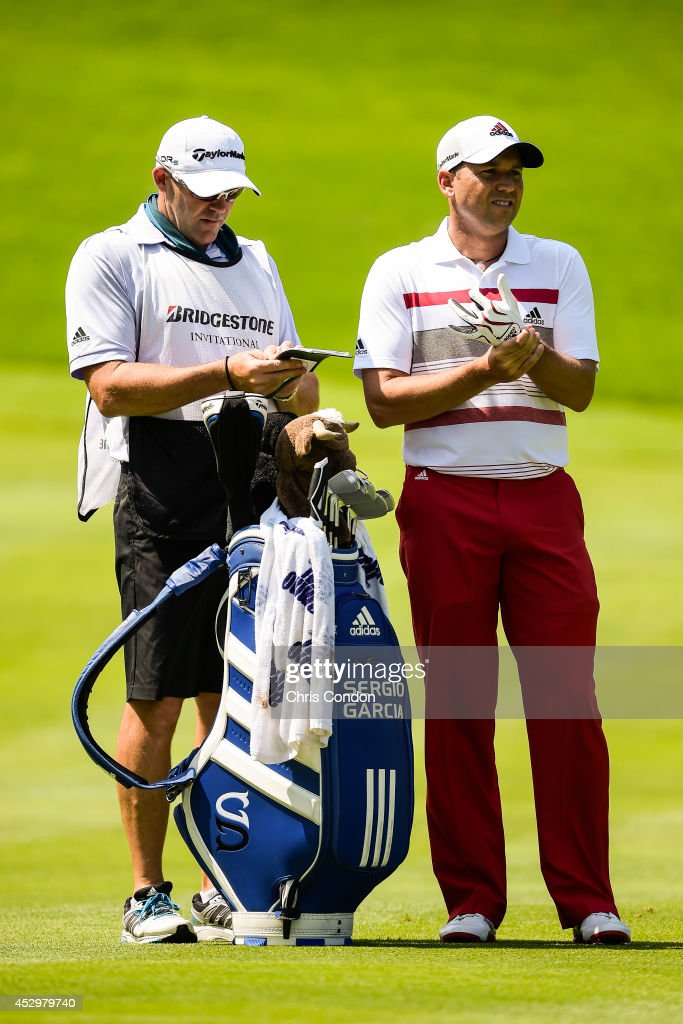 Sergio Garcia of Spain adjusts his glove on the 16th hole fairway during the first round of the World Golf Championships-Bridgestone Invitational at Firestone Country Club on July 31, 2014 in Akron, Ohio.