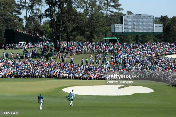 Sergio Garcia of Spain and caddie Glen Murray approach the second green during the final round of the 2017 Masters Tournament at Augusta National...
