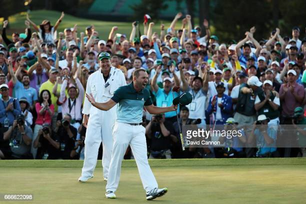 Sergio Garcia of Spain and caddie Glen Murray celebrate after defeating Justin Rose of England on the first playoff hole during the final round of...