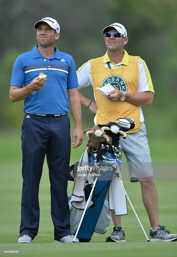 Sergio Garcia of Spain and caddie ponder a shot during the final round of the Nedbank Golf Challenge at Gary Player CC on December 8, 2013 in Sun City, South Africa.