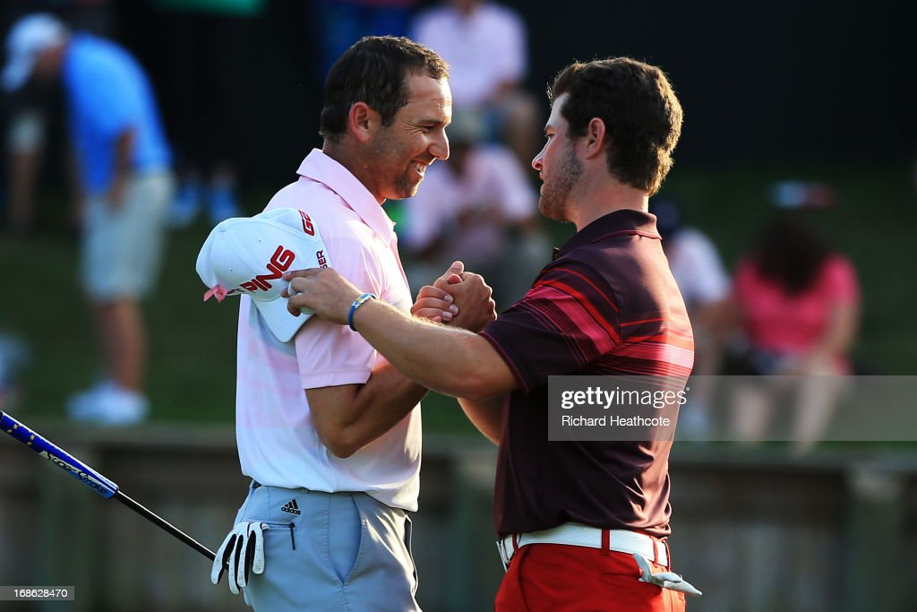 Sergio Garcia of Spain and David Lingmerth of Sweden embrace after finishing on the 18th green during the final round of THE PLAYERS Championship at THE PLAYERS Stadium course at TPC Sawgrass on May 12, 2013 in Ponte Vedra Beach, Florida.