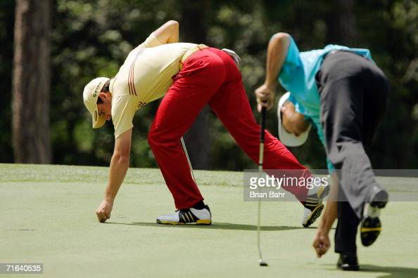 Sergio Garcia of Spain and Dean Wilson repair ball marks on the 8th green during the fourth round of The International at Castle Pines Golf Club...