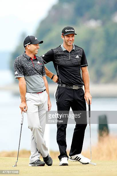 Sergio Garcia of Spain and Dustin Johnson of the United States wait on the third green during the first round of the 115th US Open Championship at...