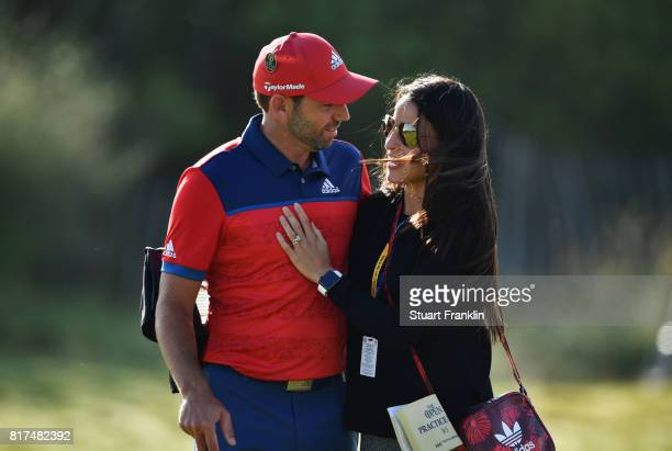 Sergio Garcia of Spain and fiancee Angela Akins embrace during a practice round prior to the 146th Open Championship at Royal Birkdale on July 18...