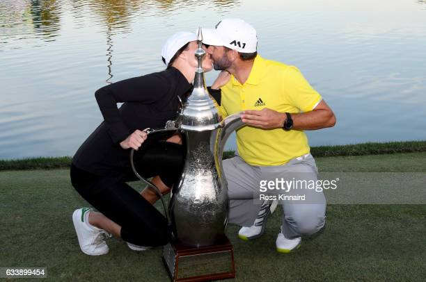 Sergio Garcia of Spain and his girlfriend Angela Akins with the winners trophy after the final round of the Omega Dubai Desert Classic at Emirates...