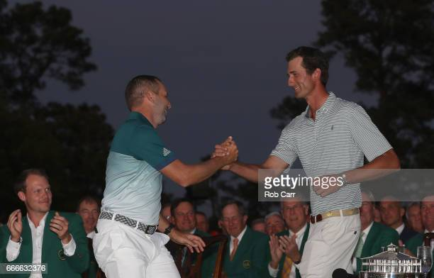 Sergio Garcia of Spain and lowamateur Stewart Hagestad of the United States embrace during the Green Jacket ceremony after Garcia won in a playoff...