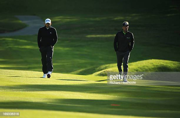 Sergio Garcia of Spain and Luke Donald of England walk down the fairway during the first round of the BMW PGA Championship on the West Course at...
