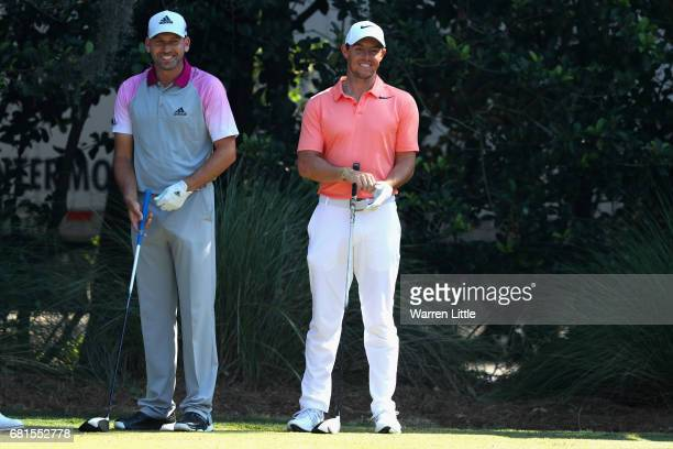 Sergio Garcia of Spain and Rory McIlroy of Northern Ireland share a joke during a practice round ahead of THE PLAYERS Championship on the Stadium...