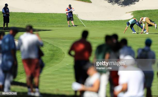 Sergio Garcia of Spain and Scott Jamieson of Scotland on the 10th green during day three of the Andalucia Valderrama Masters at Real Club Valderrama...