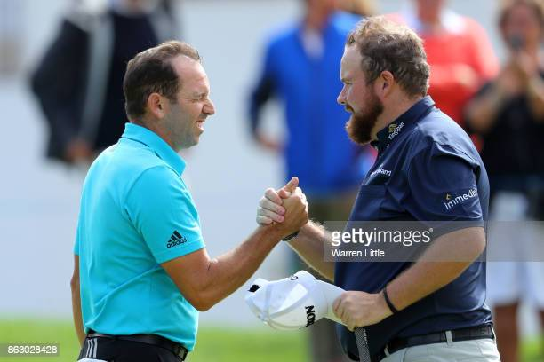 Sergio Garcia of Spain and Shane Lowry of Ireland shake on the 9th green during day one of the Andalucia Valderrama Masters at Real Club Valderrama...