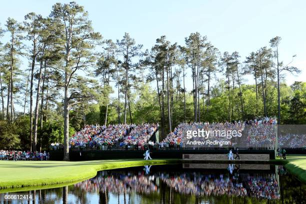 Sergio Garcia of Spain caddie Glen Murray Justin Rose of England and caddie Mark Fulcher cross the Sarazen Bridge on the 15th hole during the final...