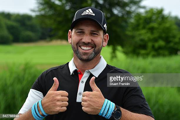 Sergio Garcia of Spain celebrates his Hilton Hotels prize after his hole in one on the 11th hole during the second round of the BMW International...