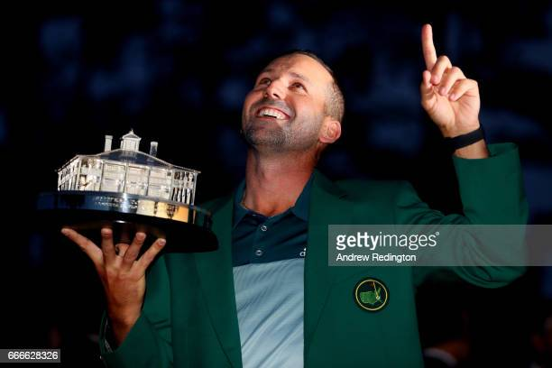 Sergio Garcia of Spain celebrates with the trophy during the green jacket ceremony after he won in a playoff during the final round of the 2017...