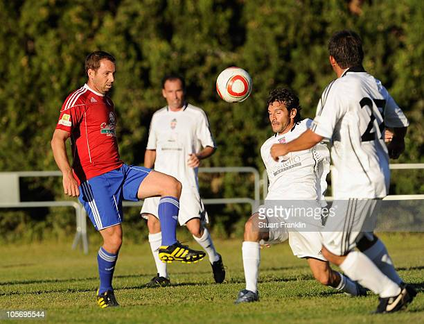 Sergio Garcia of Spain challenges Carlos Rodiles of Spain during the charity football match between players and caddies of the european tour and the...