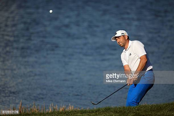 Sergio Garcia of Spain chips to the fourteenth green during the first round of the Honda Classic at PGA National Resort Spa Champions Course on...
