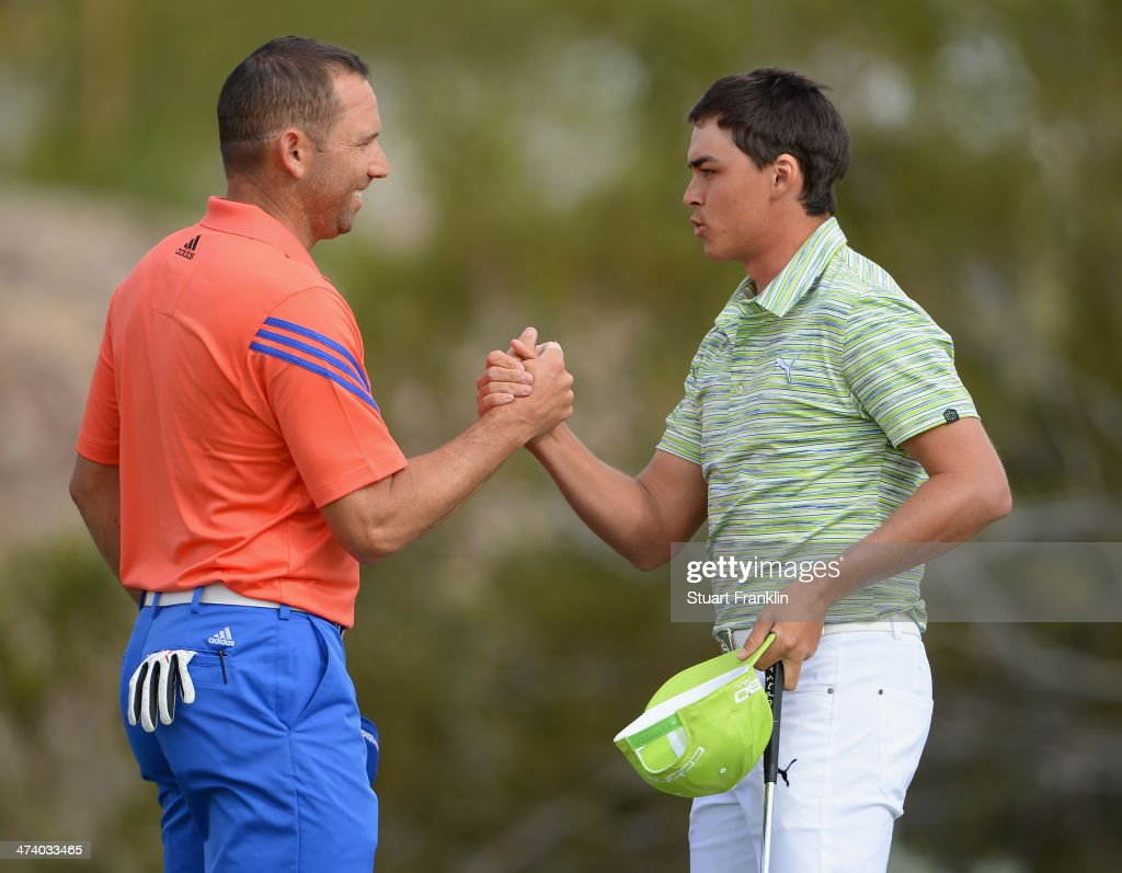 Sergio Garcia of Spain congratulates <a gi-track='captionPersonalityLinkClicked' href=/galleries/search?phrase=Rickie+Fowler&family=editorial&specificpeople=4466576 ng-click='$event.stopPropagation()'>Rickie Fowler</a> of USA on the 18th hole during the third round of the World Golf Championships - Accenture Match Play Championship at The Golf Club at Dove Mountain on February 21, 2014 in Marana, Arizona.