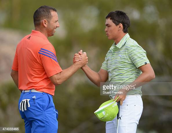 Sergio Garcia of Spain congratulates Rickie Fowler of USA on the 18th hole during the third round of the World Golf Championships Accenture Match...