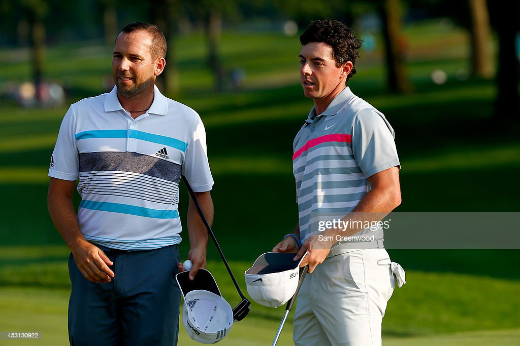 Sergio Garcia of Spain congratulates Rory McIlroy of Northern Ireland on his win after putting on the 18th green during the final round of the World Golf Championships-Bridgestone Invitational at Firestone Country Club South Course on August 3, 2014 in Akron, Ohio.