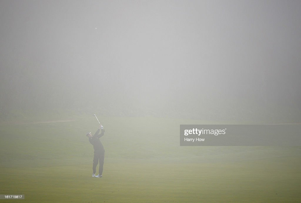 Sergio Garcia of Spain hits a second shot from the fog on the eighth hole during the first round of the Northern Trust Open at the Riviera Country Club on February 14, 2013 in Pacific Palisades, California.