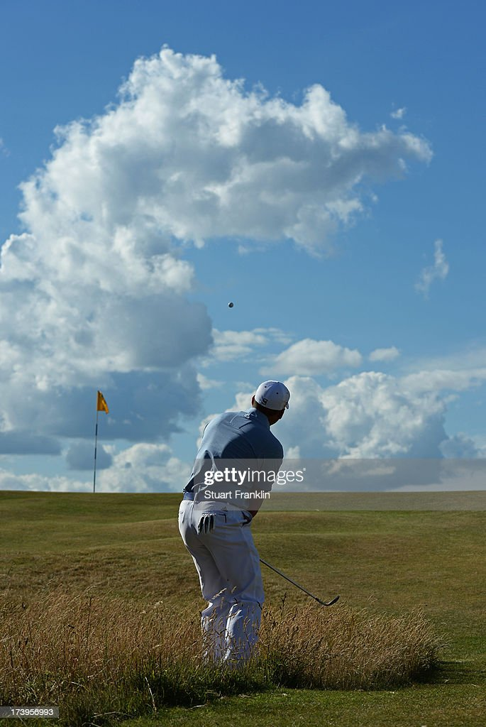 Sergio Garcia of Spain hits an approach shot on the 12th hole during the first round of the 142nd Open Championship at Muirfield on July 18, 2013 in Gullane, Scotland.