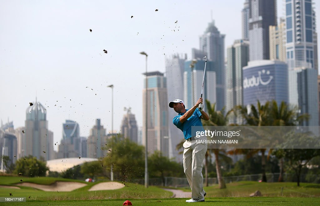 Sergio Garcia of Spain hits off the tee box during the first round of the Dubai Desert Classic golf tournament in the Gulf emirate of Dubai on January 31, 2013. AFP PHOTO/MARWAN NAAMANI