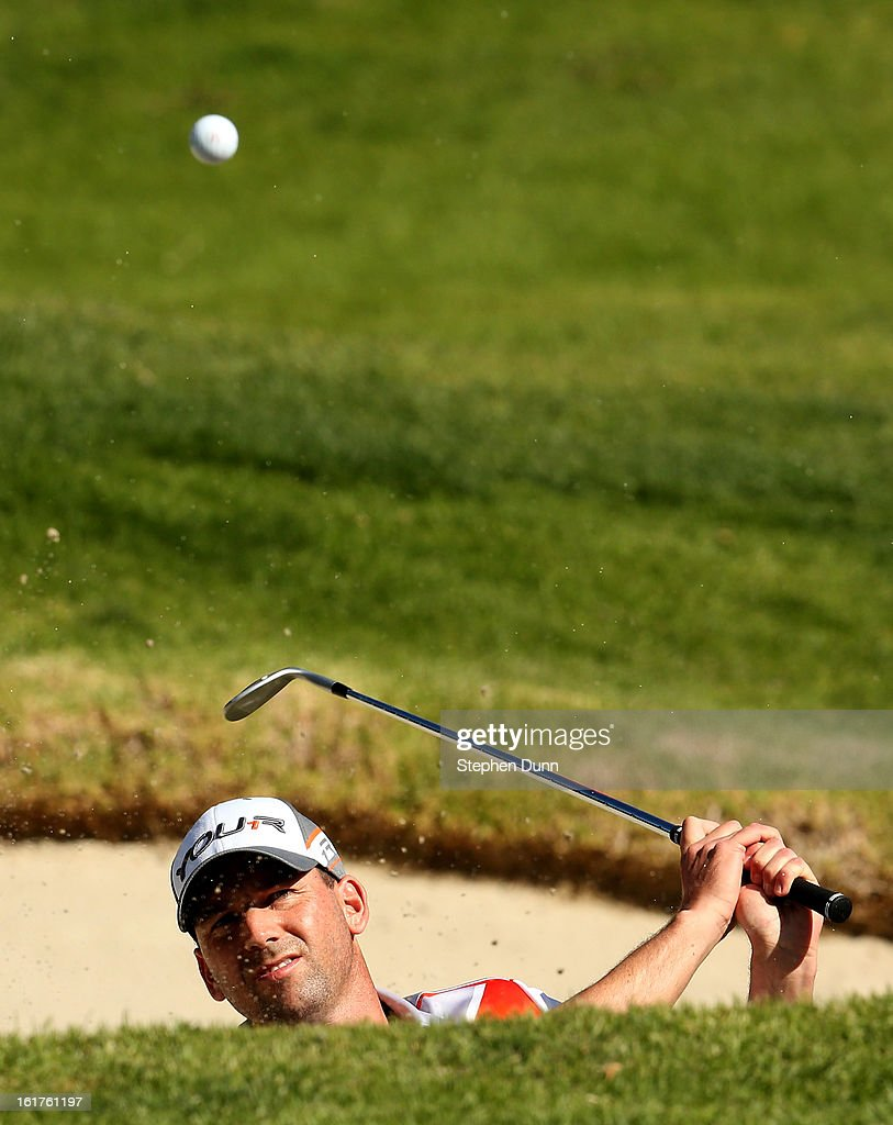 Sergio Garcia of Spain hits out of a bunker on the 14th hole during the second round of the Northern Trust Open at Riviera Country Club on February 15, 2013 in Pacific Palisades, California.
