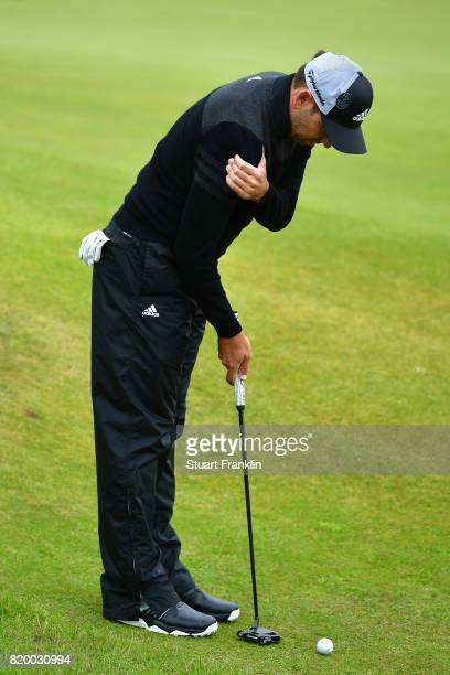 Sergio Garcia of Spain holds his shoulder as he putts on the 4th hole during the second round of the 146th Open Championship at Royal Birkdale on...