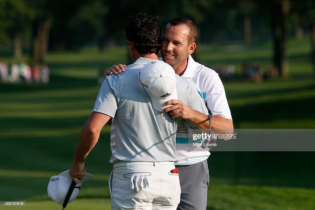 Sergio Garcia of Spain hugs Rory McIlroy of Northern Ireland after McIlroy's winning putt on the 18th green during the final round of the World Golf Championships-Bridgestone Invitational at Firestone Country Club South Course on August 3, 2014 in Akron, Ohio.