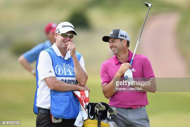 Sergio Garcia of Spain laughs with his caddie Glenn Murray during a practice round prior to the 146th Open Championship at Royal Birkdale on July 19...