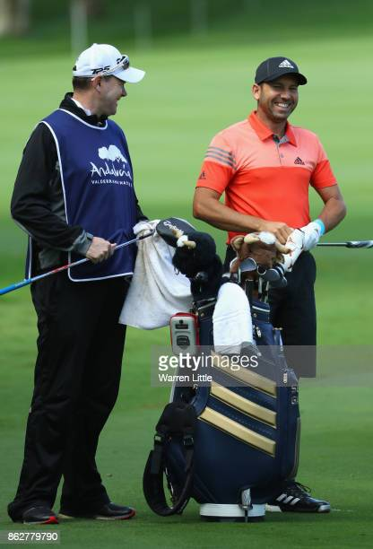 Sergio Garcia of Spain laughs with his caddie Glenn Murray during the pro am ahead of the Andalucia Valderrama Masters at Real Club Valderrama on...
