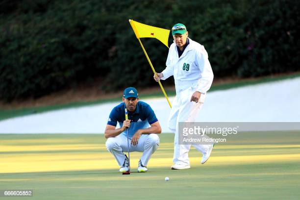 Sergio Garcia of Spain lines up a putt on the 13th hole with caddie Glen Murray during the final round of the 2017 Masters Tournament at Augusta...