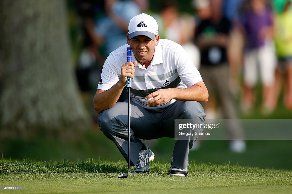 Sergio Garcia of Spain lines up a putt on the 18th green during the second round of the World Golf Championships-Bridgestone Invitational at Firestone Country Club South Course on August 1, 2014 in Akron, Ohio.