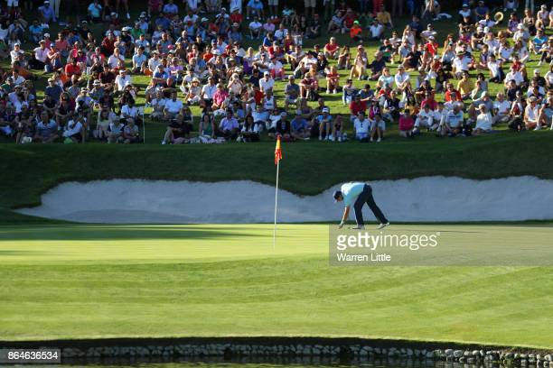 Sergio Garcia of Spain marks his ball on the 17th green during day three of the Andalucia Valderrama Masters at Real Club Valderrama on October 21...