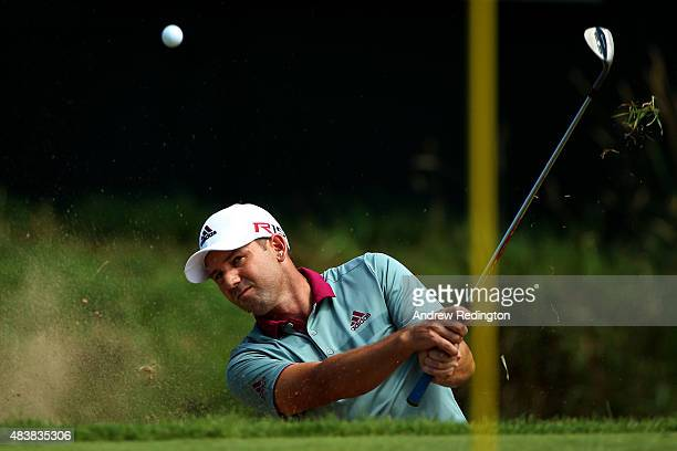 Sergio Garcia of Spain plays a bunker shot on the ninth hole during the first round of the 2015 PGA Championship at Whistling Straits on August 13...
